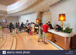 hong kong china island fortress hill harbour grand hong kong hotel lobby inside interior front desk check in guests employees