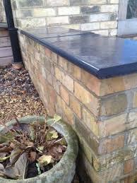 black limestone wall coping bullnosed