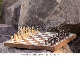 Game With Rocks And Wooden Board Chess Board Chess Pieces On Wooden Stock Photo 100 55