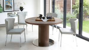 dining furniture round table. round walnut wood veneer extending dining table furniture