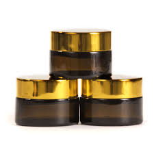amber glass jar with black or gold wadded lid white caska seal 20ml