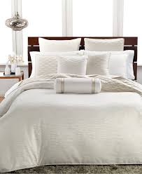 dream in the luxury of this elegant comforter from hotel collection featuring an ivory ground