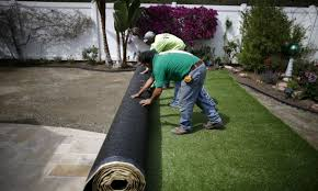 artificial turf yard. Unique Yard Rolling Out Artificial Grass In Yard To Artificial Turf Yard