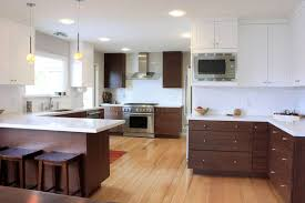 Kitchen With White Cabinets In The Top And Walnut Kitchen Cabinets