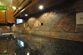 F Granite Tile And Uba Tuba With A Multi Color Slate Backsplash