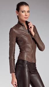 women wearing tight leather pants brunette model wearing a brown leather jacket and tight leather pants