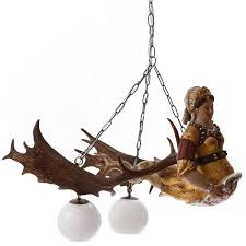 a very beautiful antique antler chandelier called baroque antique antler chandelier with carved wood