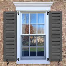 window with brown shutters in a 1002 configuration 2 panels fup faux louvers