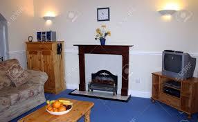 wall lighting living room. living room with fireplace and wall lights on stock photo 932652 lighting r