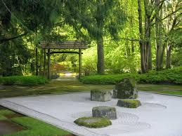 unlike a traditional garden with flowers and water the japanese rock garden or dry landscape garden often called a zen garden creates a miniature