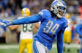 Ghanian native Ezekiel Ansah waits by the phone for the first time in his  NFL career