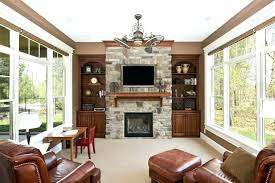stone fireplace with tv above gas mantels this marvelous has a wooden mantle just under the television for extra storage space stacked fireplac