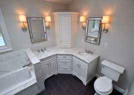 bathroom cabinetry design. bathroom light fixture with outlet plug also corner cabinet design and the of bath frame mirror cabinetry