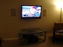 klipsch in wall speakers. make a statement on budget. want that big picture with the sound? we can do it this sony lcd hangs over basic yamaha stereo system klipsch in wall speakers