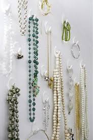 Command hooks grouped together on a wall provide an attractive and  inexpensive solution for storing necklaces. -- Finfin smyckesfrvaring:  Mamamekk