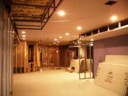 install bright lamps on minimalist basement ceiling ideas for spacious room with cream flooring basement ceiling lighting ideas