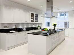 modern white kitchens beautiful chandelier hang on the ceiling dark brown wooden countertop white minimalist laminate