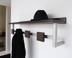 contemporary wooden wall mounted coat rack design with storage and white wall for contemporary bedroom