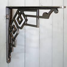 amazing beautiful black astrea decorative metal shelf brackets connect to light blue wood wall paint