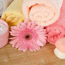 Bamboo Bathroom Rug Pink Gerbera And Towel On Bamboo Rug Stock Photo Picture And