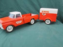 Nylint pressed steel U-Haul pickup truck and trailer