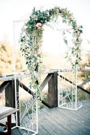 indoor wedding arches. for a simple spring backyard wedding use an arbor this one has lots of greenery\u2026 indoor arches
