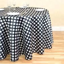 black polka dot plastic tablecloth in round satin white main