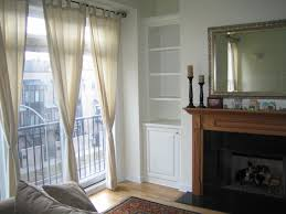 Built In Cabinets Beside Fireplace Attractive Vintage Fireplace Mantel Beside Built In Bookshelves