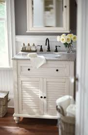 best bathroom vanities for small bathrooms. small bath? no problem. a single vanity like this one is the answer. loving its shutter doors and beautiful granite top. homedecorators.com #dreamo\u2026 best bathroom vanities for bathrooms l