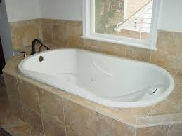 fiberglass shower and tub combo. oval white fiberglass combo bathtub with black polished metal faucet surround in light brown ceramic panel shower and tub