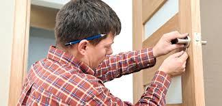 locksmith working. Yale Chubb Locksmith Working On Door Handle