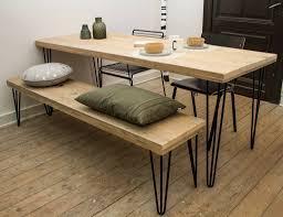 bijzondere industriele tafel van gerecycleerd steigerhout in binatie met stijlvolle scne poten van staal het