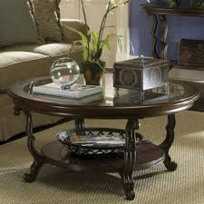 hard wood round coffee table with natural plant in small pot as centerpiece idea
