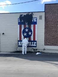 update california coach cuonzo martin resigns to take job at popular i believe in nashville mural smeared tar