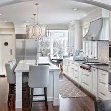 lighting over a kitchen island. unique large drum shades over kitchen island lighting a