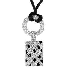 cartier panthere diamond pave and onyx white gold pendant and cord necklace for