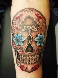 badass deadly skull tattoo designs for men  break the rules and get an unconventional tattoo of a flowery skull and crossbones contrasting characters colorful designs and soft patterns eye catching