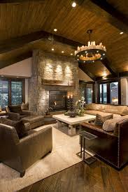 also area rug ceiling lighting dark floor exposed beams fireplace mantel leather armchair leather sofa recessed lighting round chandelier sloped ceiling