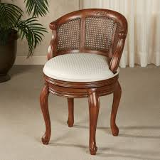 brown wooden chair with four legs combined with round white seat also curving back