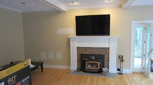 sensational design ideas installing tv over fireplace best interior mounting above for home with plan installation