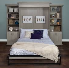 murphy style bed folded out with concrete cabinets and décor concrete shaker cabinetry hides wall mounted