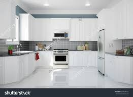 clean kitchen: interior of new white kitchen with kitchenware and clean tiles d rendering
