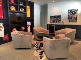 we have a sectional in one area and lounge seating in another this provides plenty of seating for all the guys when there is a game to watch