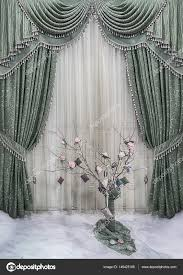 luxurious decoration of windows and walls in classical style a green curtains with a vegetable