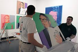 paris big andy warhol show photo essays time two museum employees prepare to hang up a painting by us artist andy warhol at the