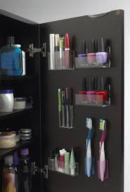 clever organization of space inside cabinets is very important in a tiny bathroom