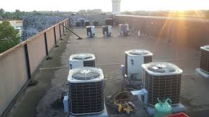 air conditioning units for apartments. conditioning units for an apartment on the rooftop of a building in columbus, ohio being serviced by: air comfort systems, inc. commercial (614)444-cool apartments s