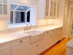 white maple cabinets with corian countertops very well done looks more expensive