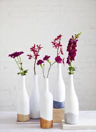 easy matte stark white and glitter on beautiful wine bottle centerpieces