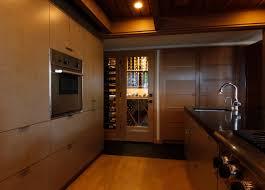 conditioned wine cellar adjacent to the kitchen bellevue custom wine cellar